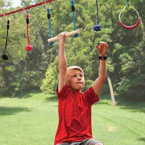 Kid moving on kids ninja warrior obstacle course