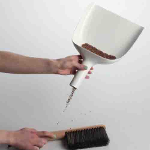 white sweeper with a funnel and brush