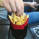 black car french fry holder filled with chips